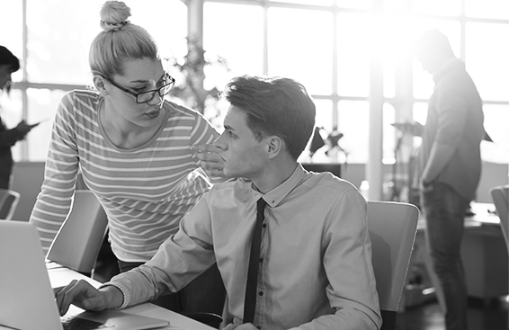 Woman and man completing a performance review with Paycom.